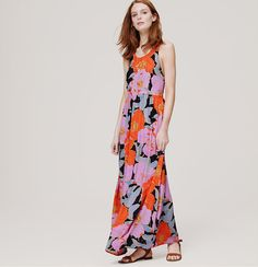 """Emblazoned with oversized blooms, we adore the strappy allure of this brightly hued maven. Halter neck. Crossover straps at back. Shirred beneath waist seam. Side zip. Lined. 41 3/4"""" from waist seam."""