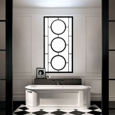 This art-deco inspired bathroom has more than a hint of old-school glamour with its monochrome colour palette.