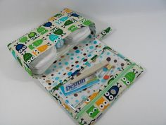 Diaper clutch!  Sew to fit the larger travel baby wipes container.  (64 wipe pack) And zipper size for other items needed.   Diapers to go with changing pad.