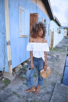 Karen Blanchard wearing an off the shoulder top with H&M wide leg jeans the Cult Gaia Ark bag