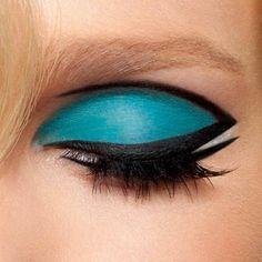 Blue and black eyeshadow defined winged eyeliner