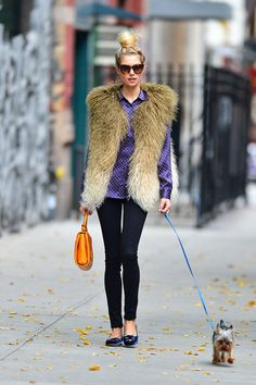 Jessica Hart - Australian model Jessica Hart sports a furry vest and polka dot shirt while taking her dog for a walk in New York City