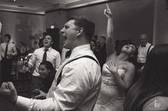 Be sure you hire the photographer for the reception, because you don't want to miss action shots like this.