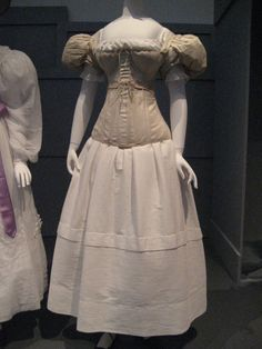 Original 1830s undergarments - chemise, corset, sleeve plumpers & corded petticoat from the LACMA exhibit.