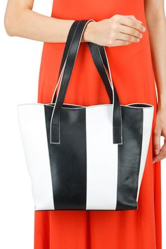 Black and white monochromatic leather tote bag BY SANYA V JAIN. Shop now at perniaspopupshop.com #perniaspopupshop #accessory #amazing #elegant #exquisite #shopnow #musthave