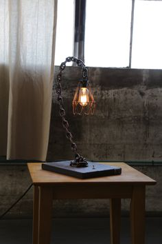 Curve - Chain Table Lamp (Industrial Rust finish) by ZHfabrications on Etsy https://www.etsy.com/listing/248306485/curve-chain-table-lamp-industrial-rust