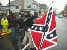 supporters of the confederate flag | nelson w winbush 78 of kissimmee stands in front of