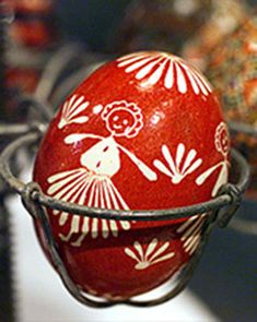 For more than 50 years, Eva Tomiuk has been making pysanky -- intricately decorated Ukrainian Easter eggs. Eva learned the art form (which originated around A.D. 980) when she was just eleven years old, and today, her creations are treasured around the world.The process involves applying multilayered designs to the surface of an egg using hot beeswax and a stylus, then dipping the egg in a series of dye baths, progressing from lighter to darker hues. One egg may take anywhere from three to…