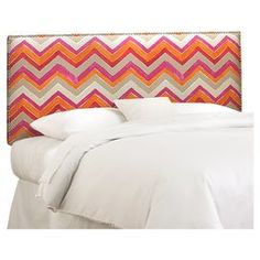 """Foam-cushioned headboard with a pine wood frame and nailhead-trimmed chevron upholstery. Handmade in the USA.  Product: HeadboardConstruction Material: Solid pine, metal, fabric, and polyester foamColor: Nomand flamencoFeatures: Handmade in the USADimensions: Twin: 51"""" H x 41"""" W x 4"""" DFull: 51"""" H x 56"""" W x 4"""" DQueen: 51"""" H x 62"""" W x 4"""" DKing: 51"""" H x 78"""" W x 4"""" DCalifornia King: 51"""" H x 74"""" W x 4"""" DNote: Product is for headboard onlyCleaning and Care: Spot clean"""