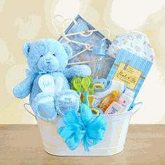 """My First Teddy"" Baby Boy Gift Basket - Welcome the new baby boy with his first teddy bear!  Snuggled inside our ""My First Teddy"" Baby Boy Gift Basket is the softest and cutest plush teddy bear in pastel blue for boys with ""My First Teddy"" embroidered on his foot. $79.95"