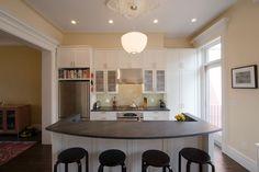 Traditional Kitchen with Balcony, Hardwood floors, Flat panel cabinets, Glass panel, Slate counters, One-wall, Kitchen island