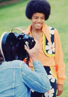 Young Michael Jackson during a photo shoot.