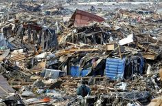 Japan sorjde tsunamins offer