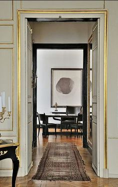 brass, black, white, silken rug -- smacks of English comedy and starched cleanliness