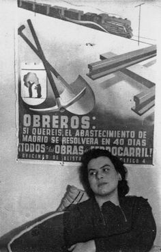 Muriel Rukeyser, American poet and writer, sitting next to a Civil War poster.
