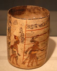 Ball Player Vase    This beautiful painted vase shows players engaged in the ancient Maya ball game. Several spectators are shown on the back of the vase. Possibly from Belize - now in the St Louis Art Museum collection