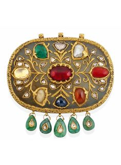 North India or Deccan | Large 'Navratna' pendant; jade, decorated with gold , typically inset with 9 different gems, and 5 drop shaped emerald pendants (possibly added later). | ca. 19th or early 20th century | 8'750£ ~ sold (Oct '12)