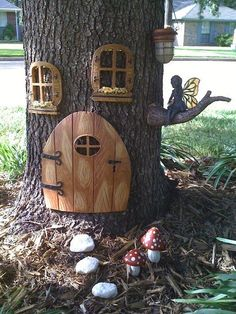 Decorate a tree in the yard as a fairy house..