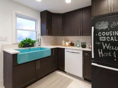 As a result of flood damage caused by Hurricane Sandy, Anthony Carrino and John Colaneri from HGTV's Cousins On Call rebuilt the Miller family's kitchen. With new cabinets, appliances, a large sky blue sink and a chalkboard-finished refrigerator, this kitchen is as beautiful as it is functional.