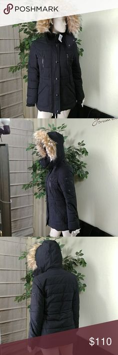"""Guess Faux-Fur Yrim Hooded Puffer Coat GUESS Faux-Fur-Trim Hooded Puffer Coat, size small, color black, tand collar, removable hood with fake-fur trim, zipper front with snap-button overlay, long sleeves with storm cuffs, allover quilting; GUESS logo at left arm,hinched at waist, fleece-lined slit pockets at hips; zip pockets at chest and left arm; two interior pockets, polyester fill, lined heavyweight, hits at hips, measures approx. 28""""L,  compare $225.00 comes new without tag as closeout…"""