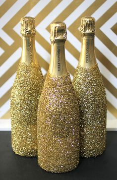 Sparkly Champagne Bottle DIY!  Bottle of Champagne or sparkling wine  Super 77 adhesive spray Craft glitter Latex gloves Drop cloth or old sheet