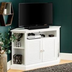 Utilize your entertaining space with this space-saving, corner console that supports TVs up to 55 inches. This transitional style TV stand is constructed of high-grade MDF with a rich painted finish and beautiful louvered doors. Its added height, adj Wood Corner Tv Stand, Corner Tv Console, Black Furniture, Cheap Furniture, Living Room Furniture, Tv Stand Plans, Flat Panel Tv, Entertainment Stand, Room Essentials