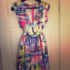 Multicolor Cut Out Dress Very cute, fun, flirty dress for any occasion with cut out sides. Brand new w tags Dresses