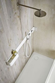 Rexa Design Design by Giulio Gianturco Collection Ergo-nomic Corian® bathroom wall shelf / shower tap Bathroom Toilets, Laundry In Bathroom, Bathroom Fixtures, Corian Shower Walls, Shower Taps, Bathroom Storage Shelves, Shower Shelves, Bad Inspiration, Bathroom Inspiration