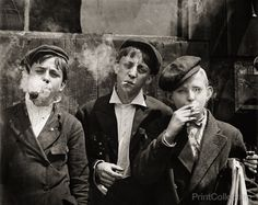 Newsies at Skeeter's Branch, Jefferson near Franklin. They were all smoking. Location: St. Louis, Missouri. 11:00 A. M . Monday, May 9th, 1910. Photographed by Lewis Hine.