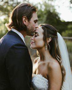 If you're looking to achieve a half-up, half-down style, add two or three short strands of hair to frame the face. A long veil and tear drop earrings makes the look even more elegant.