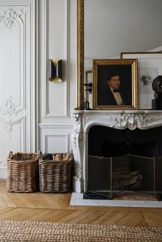 fireplace with oil portrait and large baskets holding firewood - french apartment Home Design, Salon Interior Design, Home Interior, Luxury Interior, French Interior Design, Design Ideas, Design Projects, Interior Stylist, Design Hotel