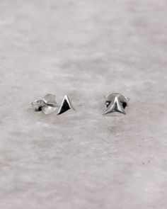 Faceted triangle stud earring, sterling silver.