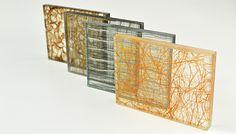 Laminated glass with fabric interlayer