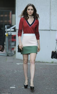 Looking lovely: Lily stunned in a bright patterned top and two-tone skirt