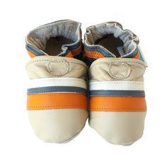 COLIN by cadeandco.com  Nothing regimental about these stripes. Orange, cream and grey accents on a base of sand-colored leather. Casual, but suitable for almost any excursion. These feet are going places.  All-natural leather, including lining. With real, suede sole.  Handcrafted in America.