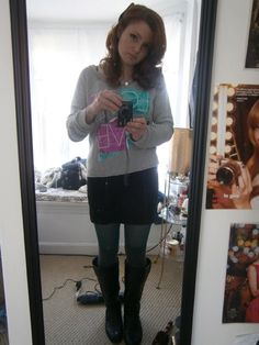 """Outfit of the Day: January 3rd, 2014. Gray """"Love"""" graphic sweater, black bodycon skirt, green tights, black riding boots."""