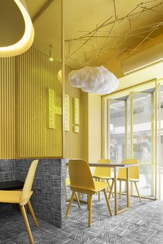 construction union designs café based on childhood doodles construction union has designed an eye-catching interior for the hi-pop tea restaurant in china, defined by nostalgia inducing scribbles. Design Café, Cafe Design, Store Design, Design Shop, Restaurant Interior Design, Interior Design Studio, Retail Interior, Yellow Interior, Interior And Exterior