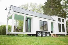 The Roost 36: a tiny home designed for families, from Perch and Nest.  There's plenty of window space, a fron porch, and it's mobile!