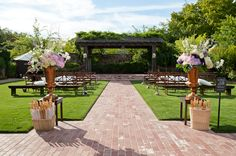 """elegant wedding decor. LT- """"Like that there are benches and seats. Also like their signage."""""""