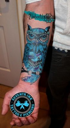 Owl tattoo man arm