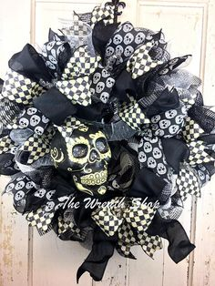 (Sold out, but this sop has other wreaths) Day of the Dead Skull Wreath  Halloween Skull Wreath