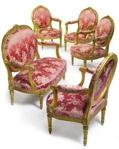 A LOUIS XVI STYLE CARVED GILTWOOD FIVE PIECE SALON SUITE France, circa 1880's  upholstered with a later pink silk damask, the crest with a musical trophy comprised of daisies, roses, laurel and a flute.