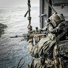 """Operator of Italian Navy Special Forces """"G.O.I.""""during a naval assault training."""