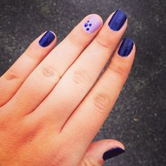 No matter how deep and dark you nails are, a fun accent nail can turn them playful - like in this design b...