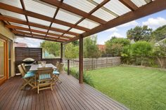 Deck with pergola and laserlight roofing #deck #roofing