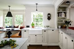 Beautiful kitchen - love the built in shelves under the arch