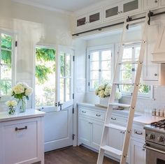 Farmhouse Touches. I love the ladder, so unexpected!