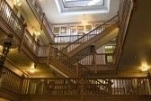 Interior shot of open retail area with many old wooden staircases stock photography
