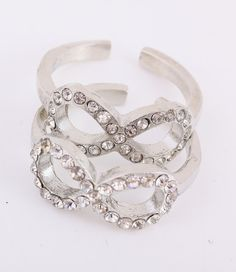 This ring features an infinity design lined with sparkling crystals, this ring is absolutely radiant. Grace your hand with this beautiful ring. Size 6.5