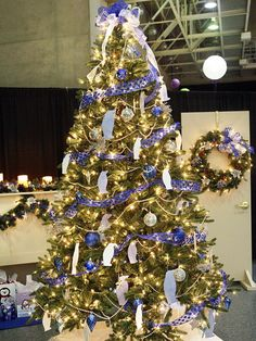 Blue-and-Silver Christmas Tree:   A blue-and-silver-theme Christmas tree brings serenity to the often-hectic holiday. Soft white lights, silver beaded garland, and shear ribbon with blue polka dots provide a tranquil scene. Add sparkly silver penguin cutout ornaments, an oversize blue-and-white gossamer bow tree topper, and fun disco ball ornaments for a light-hearted Christmas tree.  Editor's Lighting Tip: Don't overload your circuit with Christmas lights. Limit each circuit to 1,400 watts. If other lights in your house dim when you turn on the Christmas lights, your circuit is overloaded.